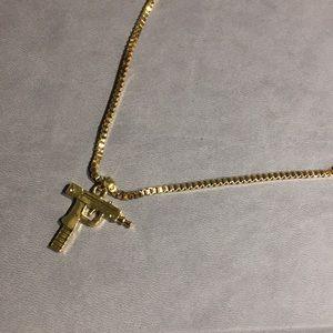 Gold uzi necklace